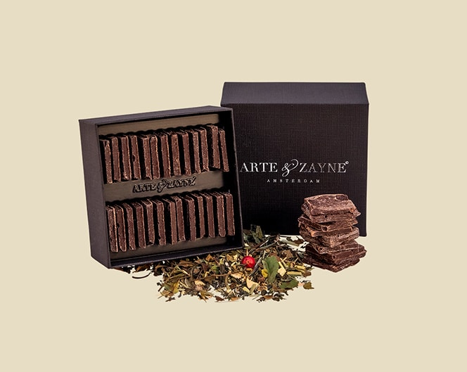 TLC Luxury Handmade Chocolates From Arte and Zayne Shown here In Their Gift Box Presentation. Crafted From Loose Leaf Organic Tea And High Quality Chocolate